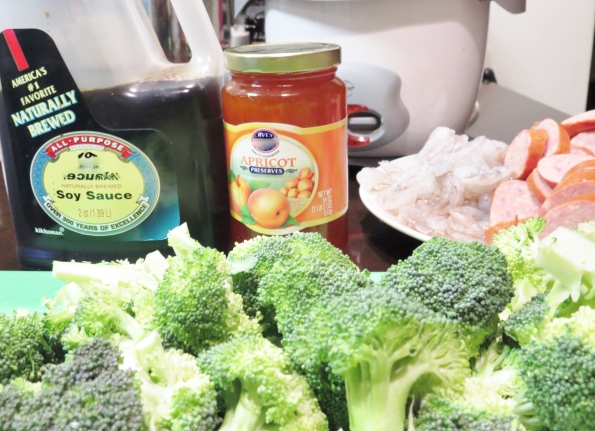 Ingredients for Shrimp and Broccoli Dinner: Broccoli, Soy Sauce, Apricot Preserves, Shrimp and Sausage...the rice cooker is in the back