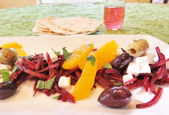 marinated beet salad with juicy fresh orange segments, cured olives and salty, crumbly feta cheese.