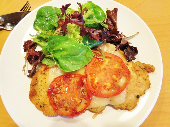 Chicken Schnitzel with melted mozzarella and salad