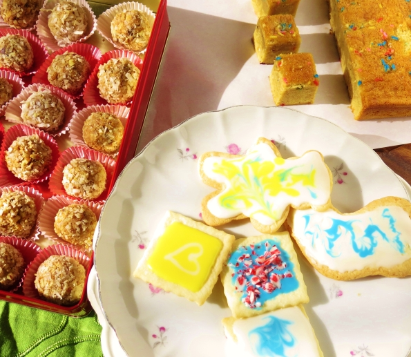 A trio of cookies: one no bake, one bar cookie and one fully decorated rolled out sugar cookie