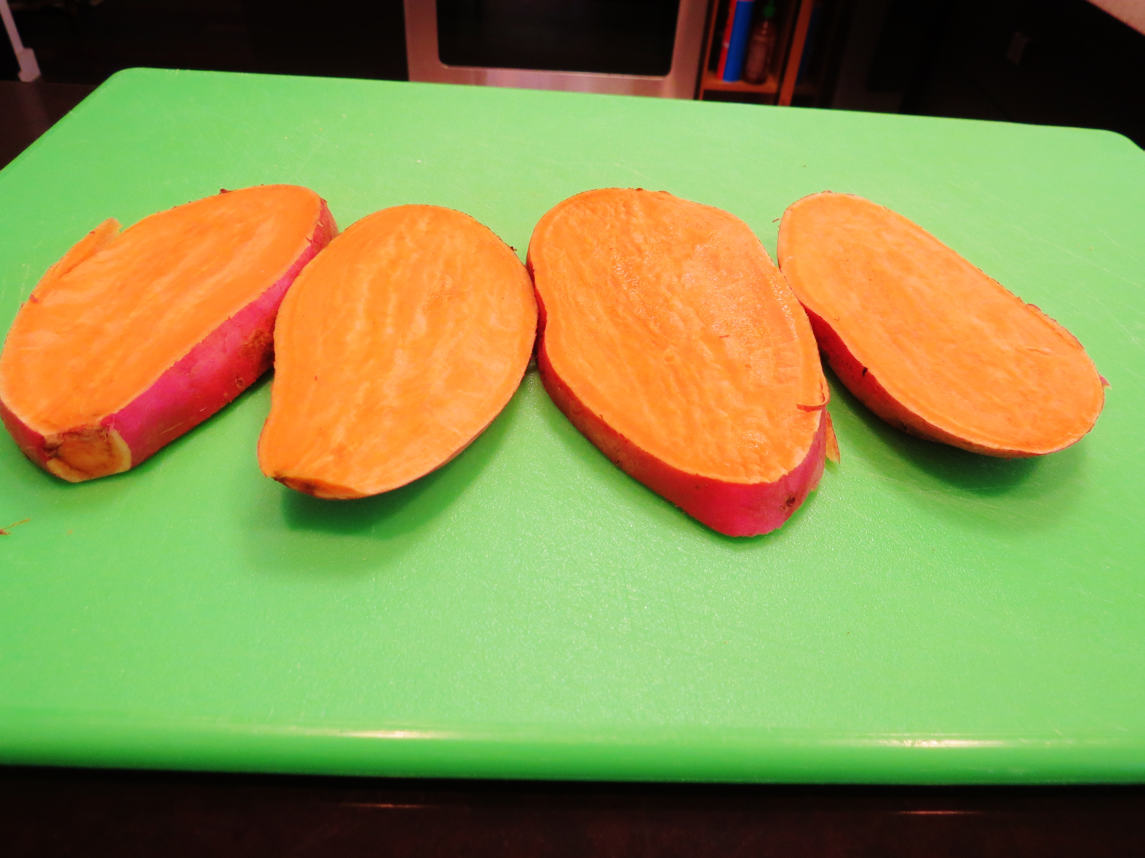 """Cut the sweet potato into """"steaks"""" about a half inch thick."""