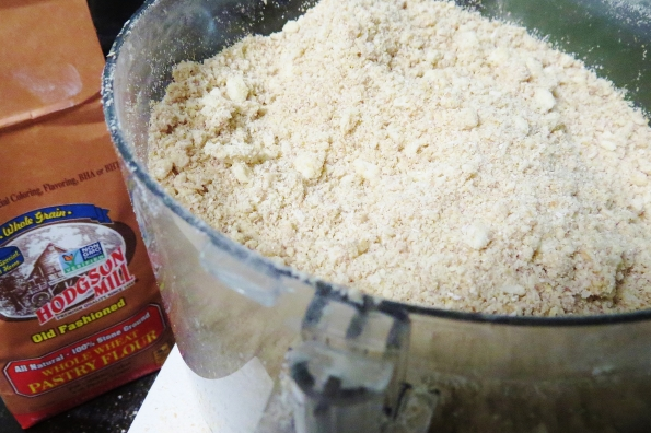 A food processor takes most of the hard work out of a homemade pie crust. Pulse some salt, butter and shortening with the whole wheat pastry flour. Add and egg and water and you're done