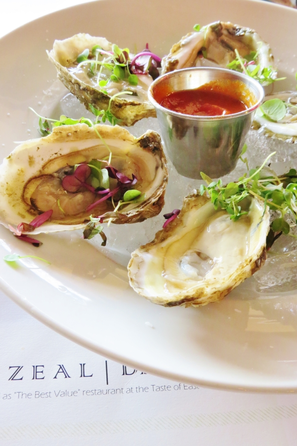 The oysters are fresh, delicious and topped with a bit of micro greens