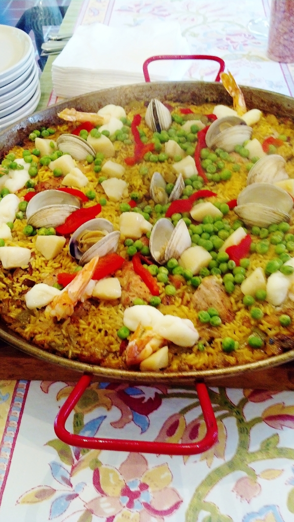 the finished paella, loaded with pork, chicken, clams, shrimp, scallops